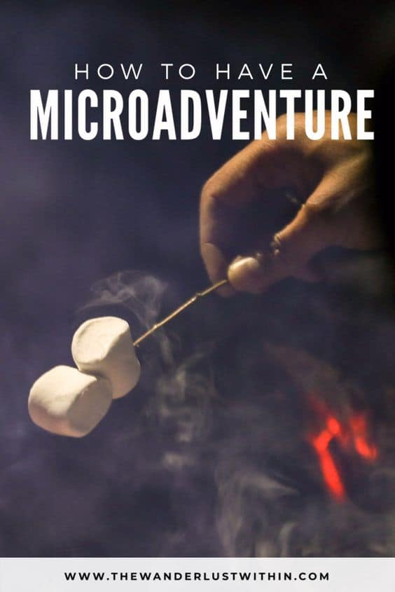 hand is roasting marshmellows on a bbq camp in bedfordshire on a microadventure in the uk