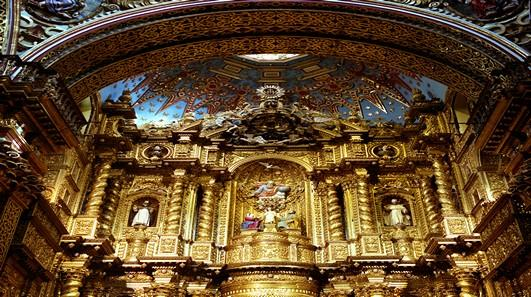 inside of a church covered in gold in quito in ecuador