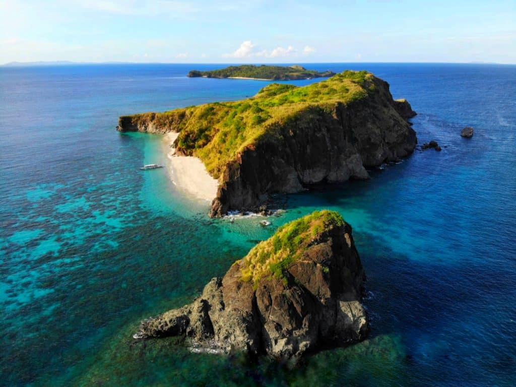 drone view of deserted islands of Caramoan in the Philippines surrounded by turquoise clear waters with white sand beaches. this is one of the hidden gem islands in asia
