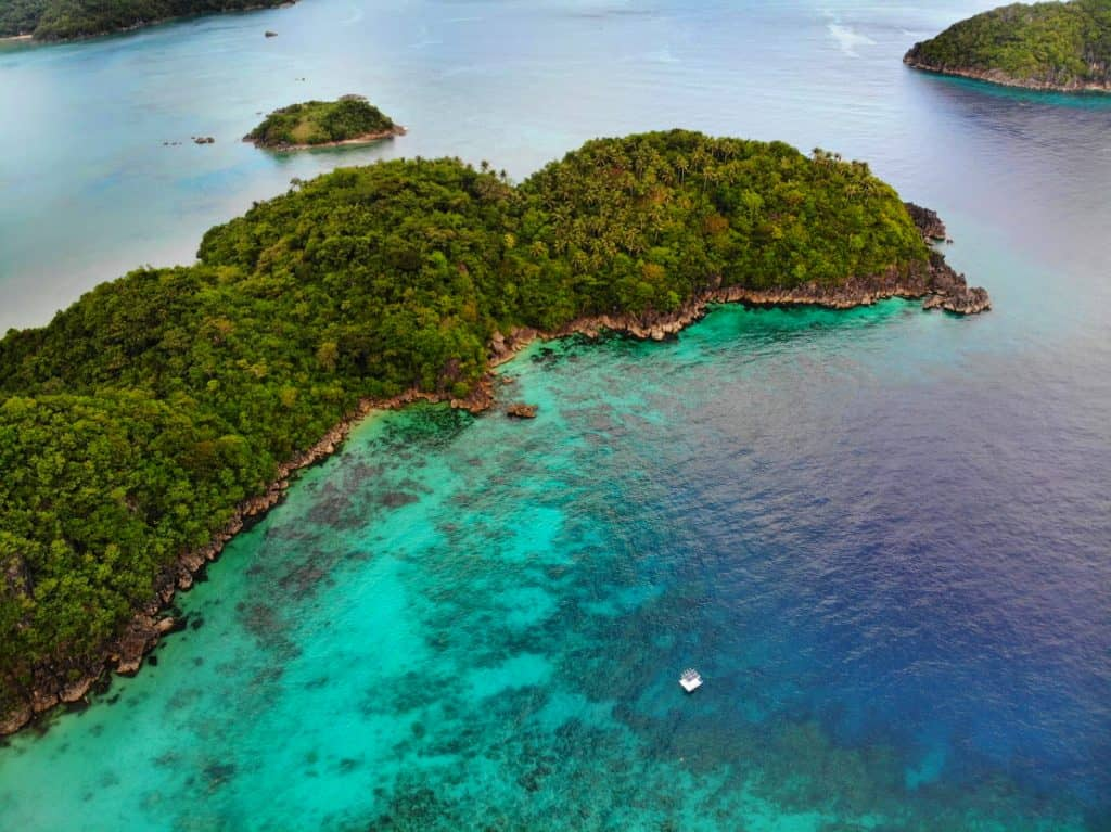 Aerial view of tropical lush islands and blue seas of philippines hidden gem, Caramoan Islands. taken at Tugawe cove resort