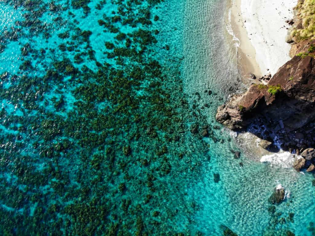 Aerial view of rocks and turquoise seas of the Caramoan Islands in philippines at tugawe cove resort