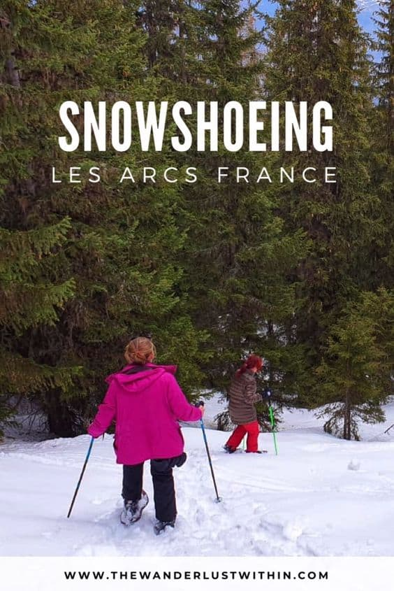 women snowshoeing downhill in les arcs france