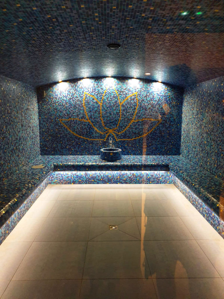 indoor steam room with blue mosaic tiles in Nama Springs in Les Arcs