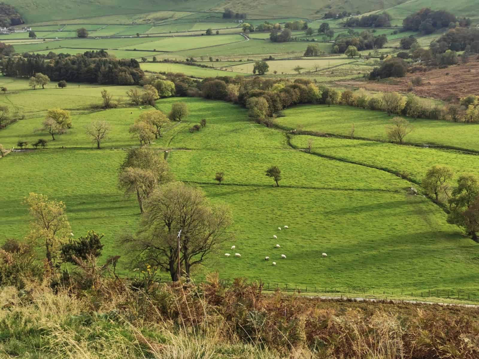 The Wanderlust Within - Green hills of Castleton in the Peak District in England