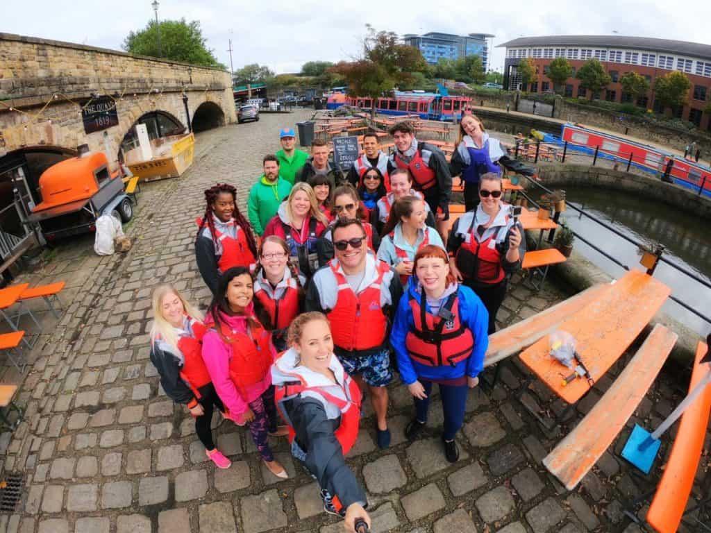 18 people in life vests taking selfie