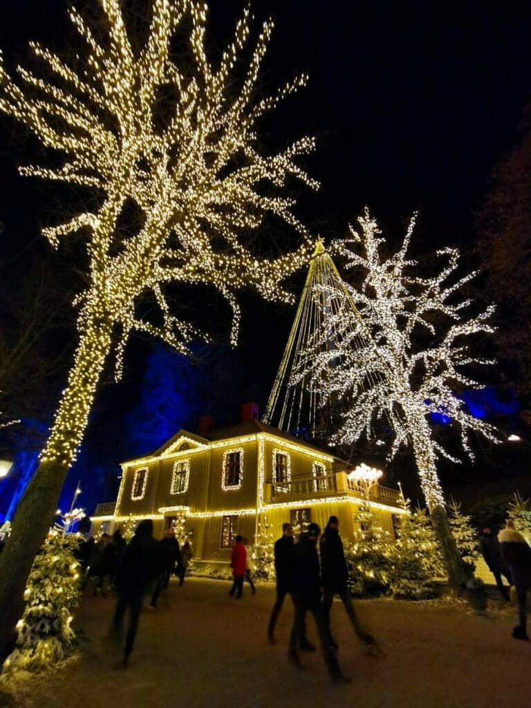 Christmas lights decorate trees and buildings at Liseberg Christmas Market