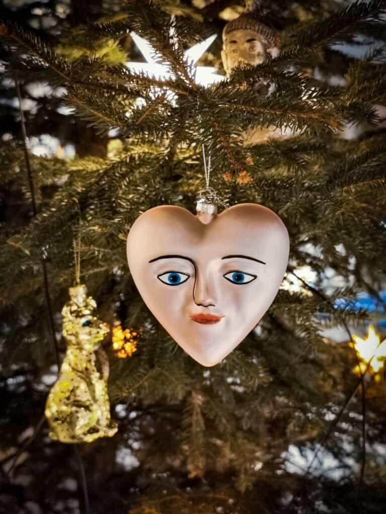 heart shaped christmas tree decoration with a face on it