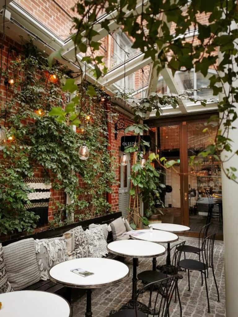 Gothenburg Christmas markets - cosy outdoor seating and plants growing up the wall of an orangery in Gothenburg at kafe magasinet