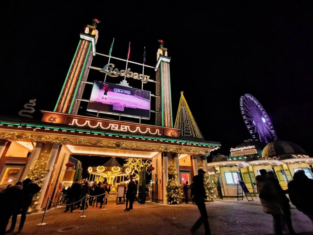 entrance to liseberg theme park lit up in neon lights at christmas time at the swedish christmas markets in gothenburg