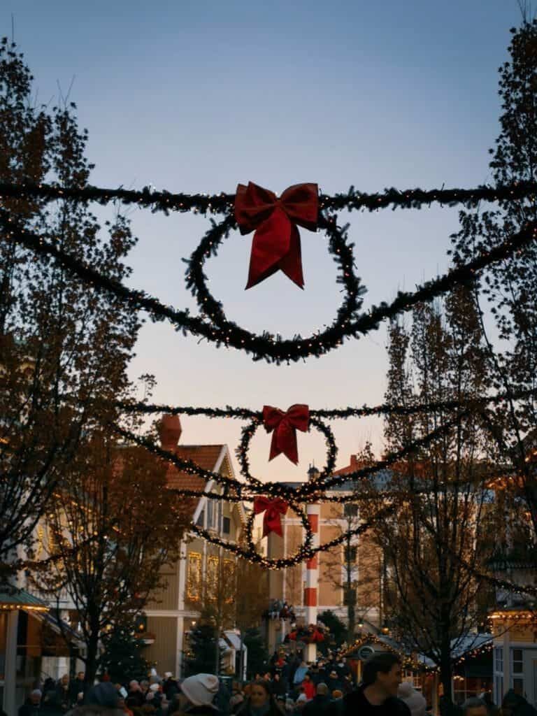 Christmas wreath decorations line the streets of Liseberg Christmas Market in Gothenburg