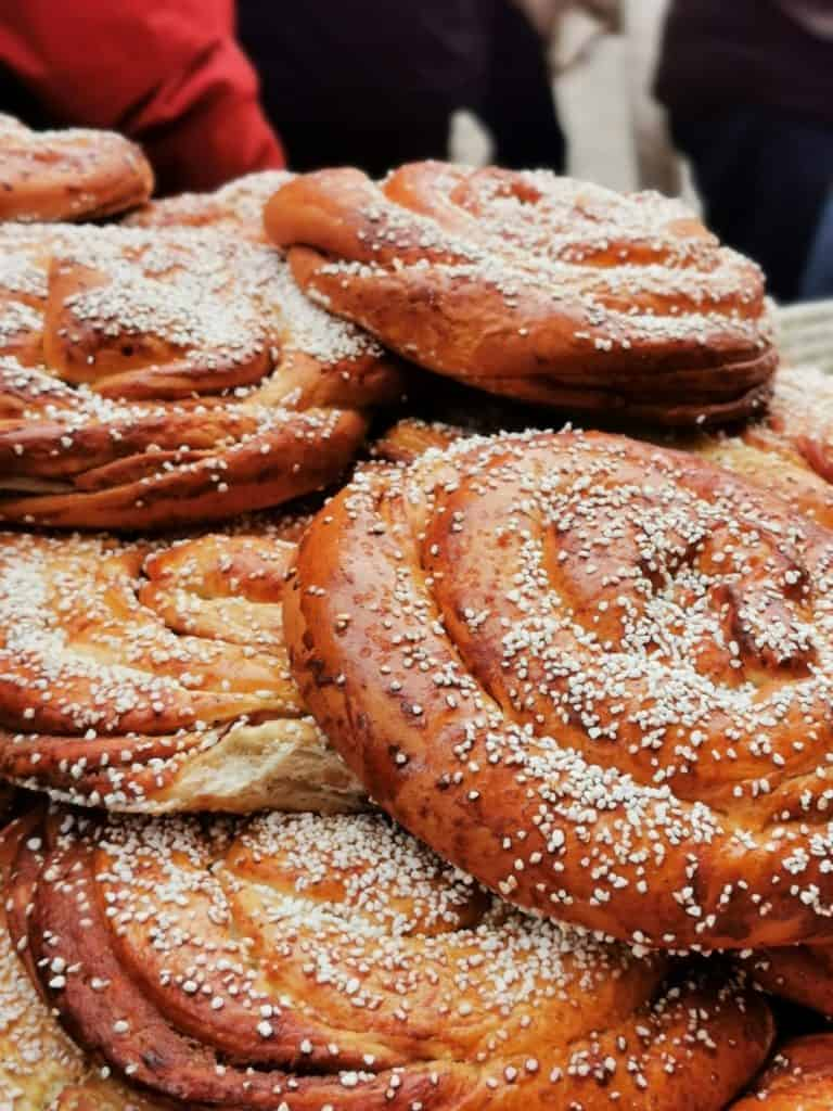 Large swedish cinnamon rolls stacked on top of each other at Gothenburg Christmas Market in Haga, Sweden