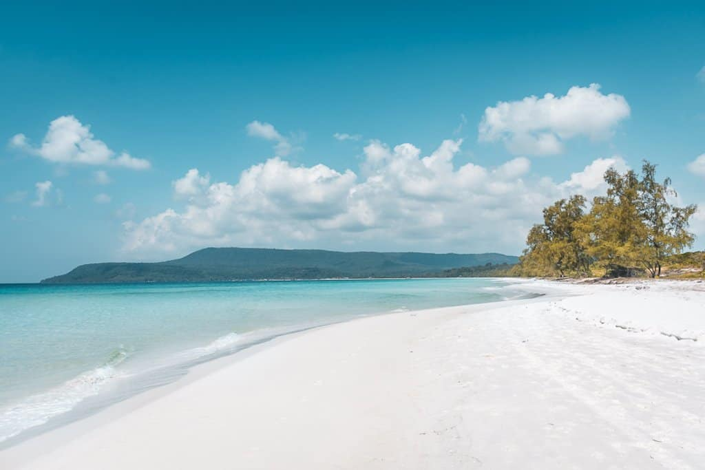 a whiter than white sand beach and turquoise blue water of a deserted island in cambodia called koh rong, one of the most beautiful islands in asia