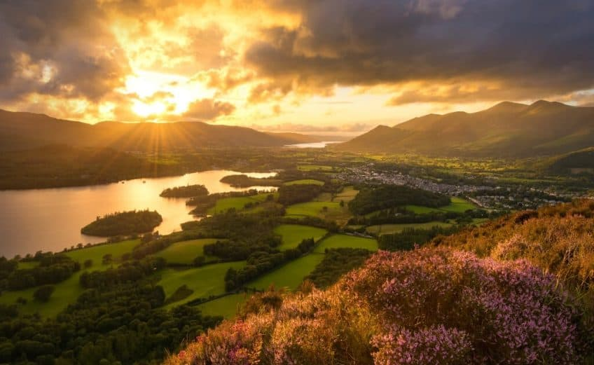 sunset above heather and hills of lake district england perfect for an airbnb getaway