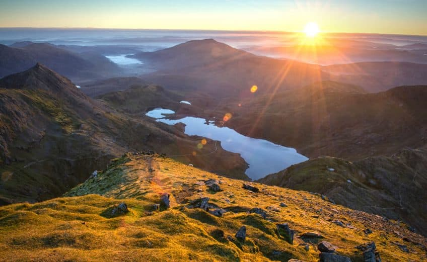 National parks in Wales - Snowdonia view of lake at sunrise with mountains surrounding