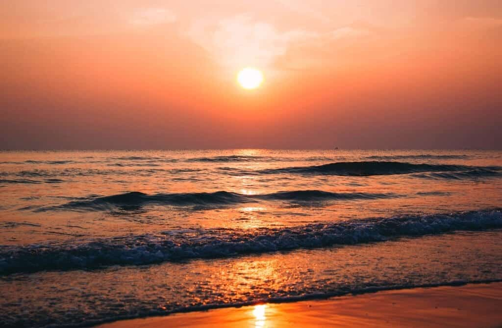 caption sunset sea ocean