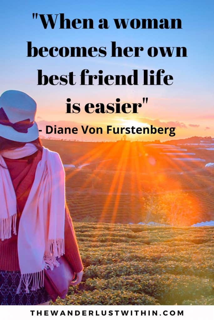 motivational inspirational solo travel quote saying When a woman becomes her own best friend life is easier. by Diane Von Furstenberg a girl in hat and pink scarf sits by vineyards on her own and enjoys sun beams from a sunset on her own solo travel quotes