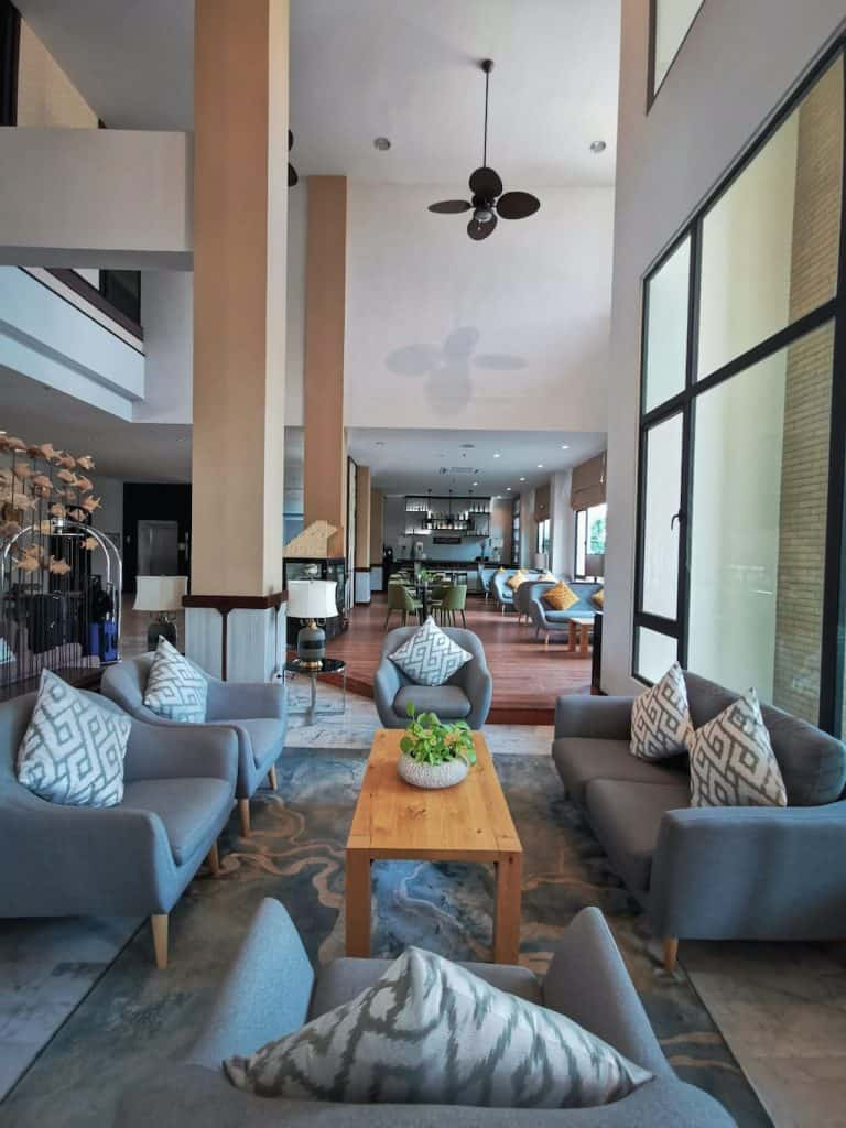 lobby of hotel called amari Vang Vieng in Laos with grey modern furnishings