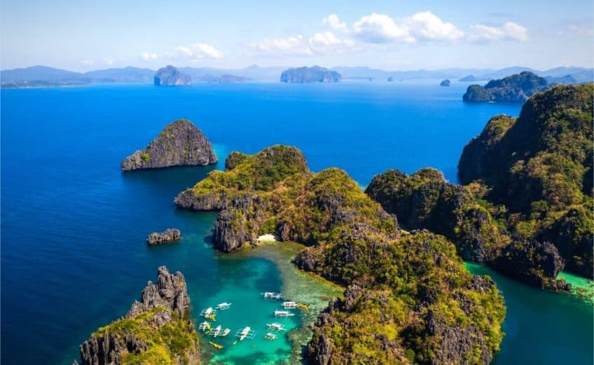 beautiful islands in asia to visit, view from above of blue water and green tropical trees