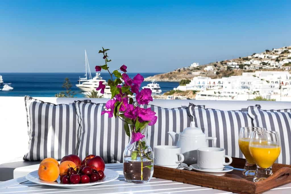 airbnb in mykonos with outside view on terrace of bay bees with fruit juice