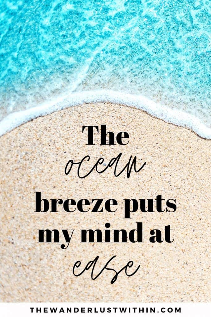 short beach quotes with blue water and sand saying The ocean breeze puts my mind at ease.