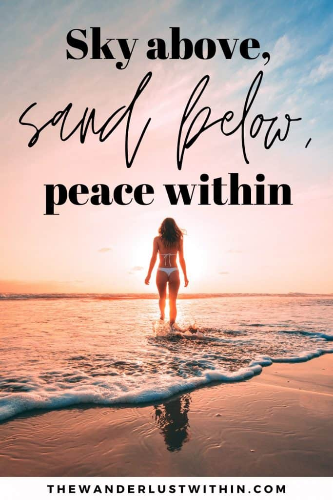 girl stands in sea with pink sunset and quote beach saying Sky above, sand below, peace within.