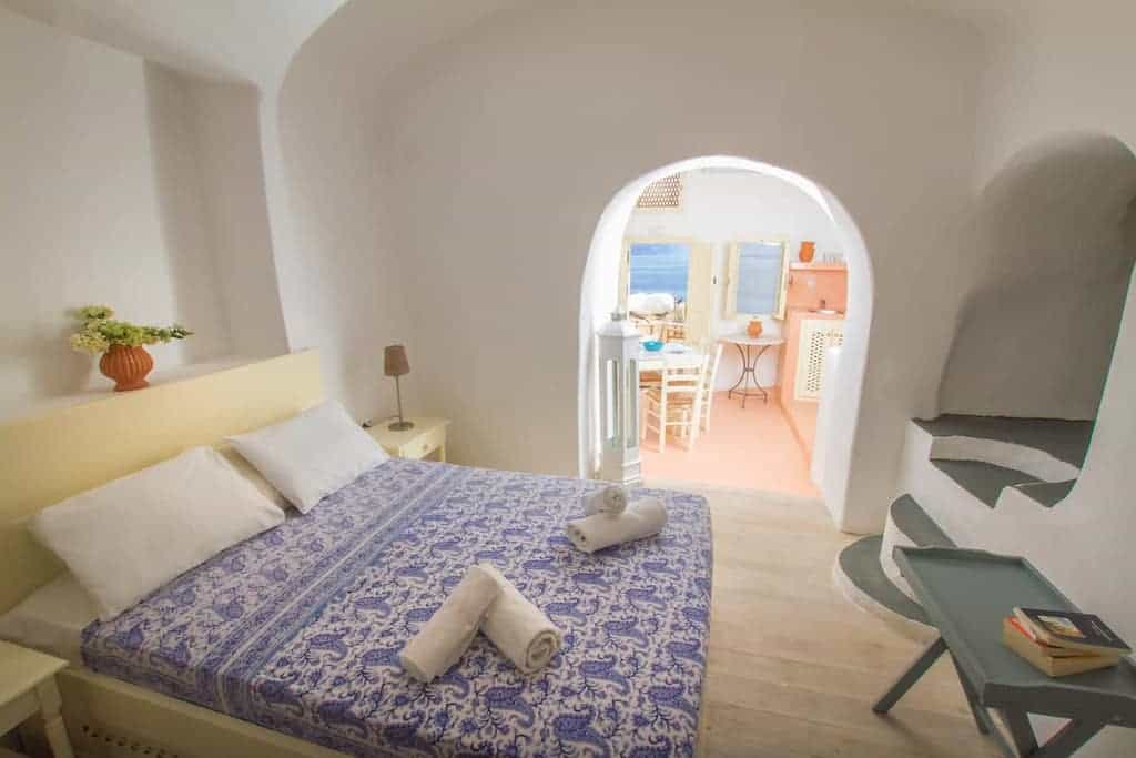 Airbnb santorini greece vacation with white walls and simple decorations in airbnb