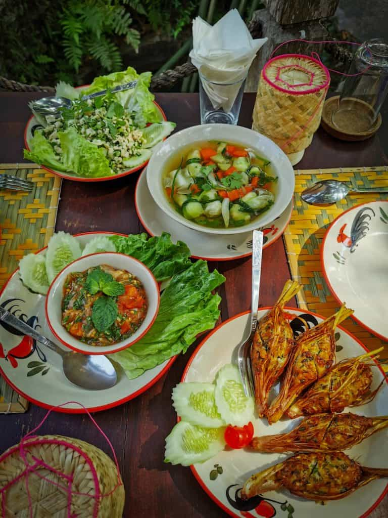 4 dishes of traditional laos food made in a cooking class in Luang Prabang