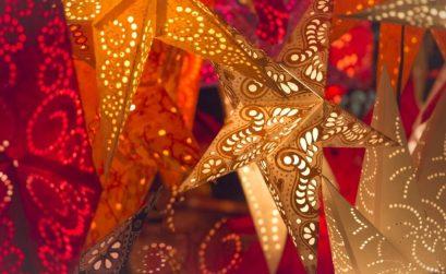 decorated star paper lanterns hanging for sale at Gothenburg christmas market
