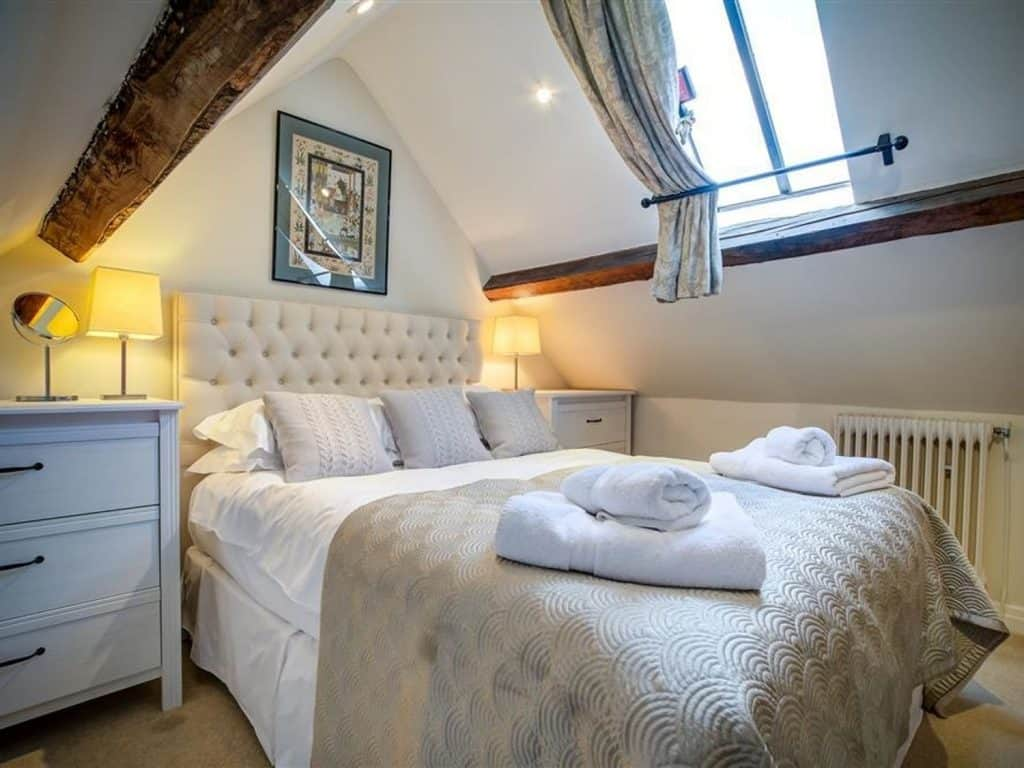 Hayloft cotswolds airbnb bedroom with beams