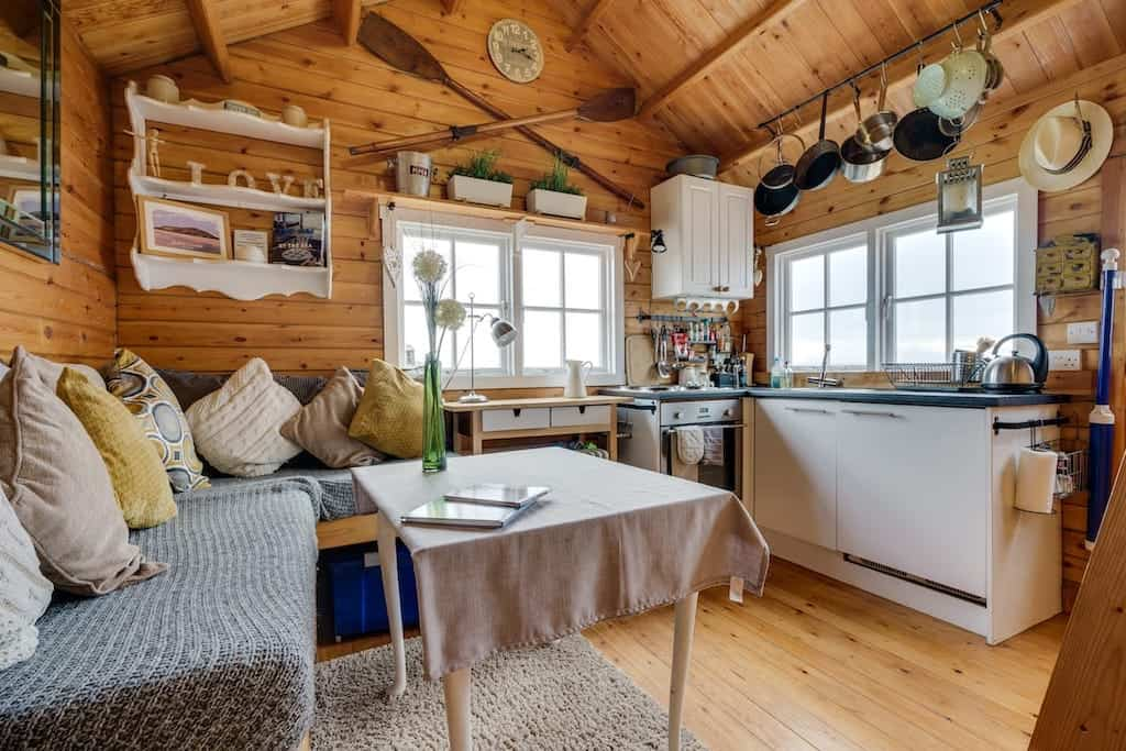 best airbnb lake district with cosy cabin interior and hot tub
