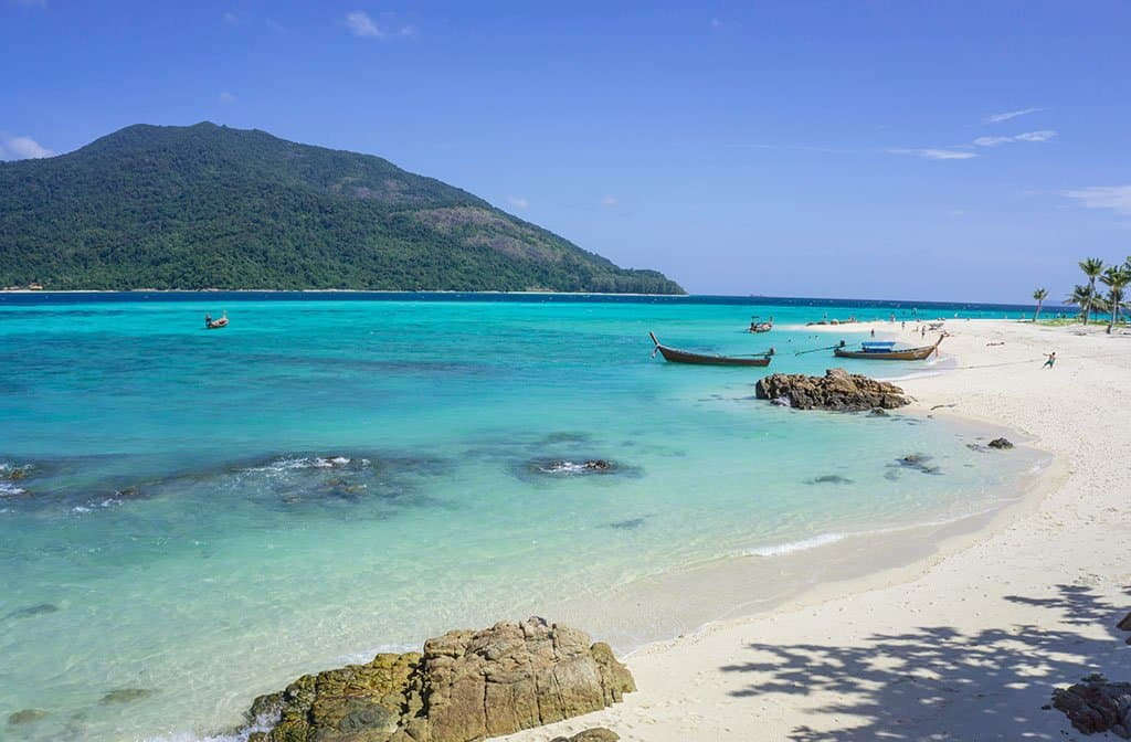 turquoise blue waters and white sand beaches in Thailand on island of Koh Lipe Islands of asia