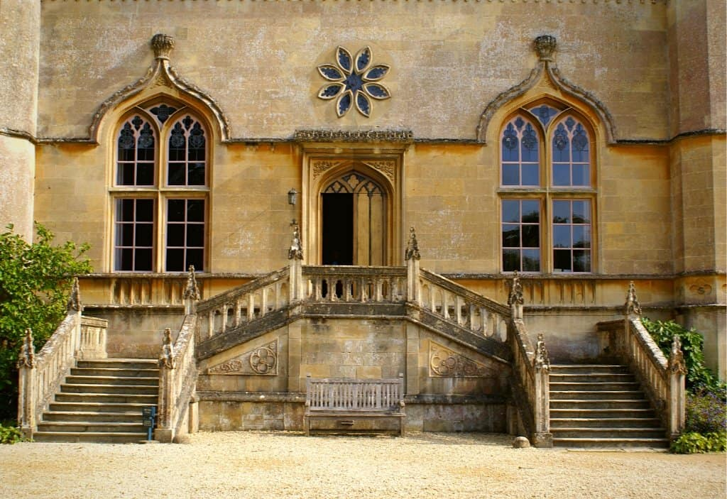 front of lacock abbey with windows and doorway cotswolds villages