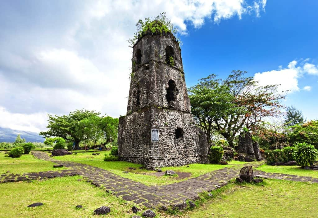 an old ruined church in Legazpi Philippines in Bicol with plenty of greenery over growing in the stones of Cagsawa Ruins