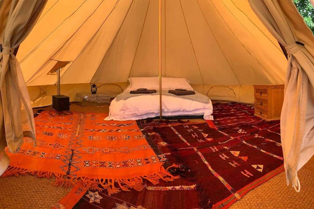 Lightfoot's Farm Furnished Bell Tent and Breakfast New Forest glamping spots with inside of bell tent and bed