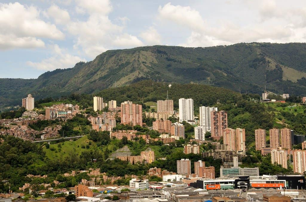 high rise buildings in the city of Medellin in Colombia with green mountains in the background