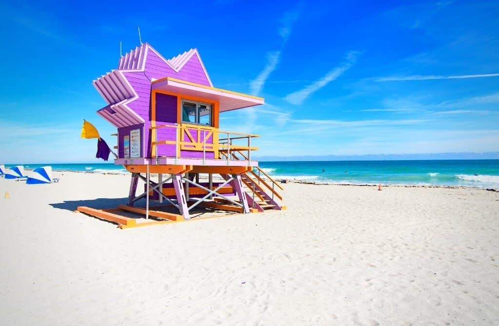 miami beach quotes with purple and orange hut