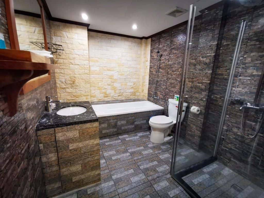 grey mosaic tiled bathroom