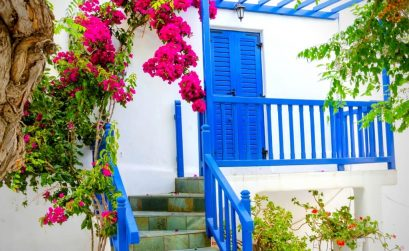 airbnbs in mykonos with blue doors and pink flowers