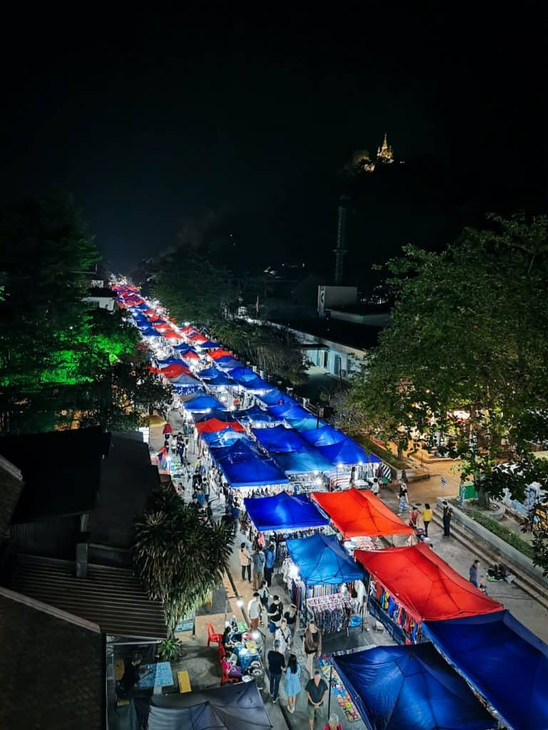 view from above of red and blue market stalls in Luang Prabang selling goods at the night market in laos