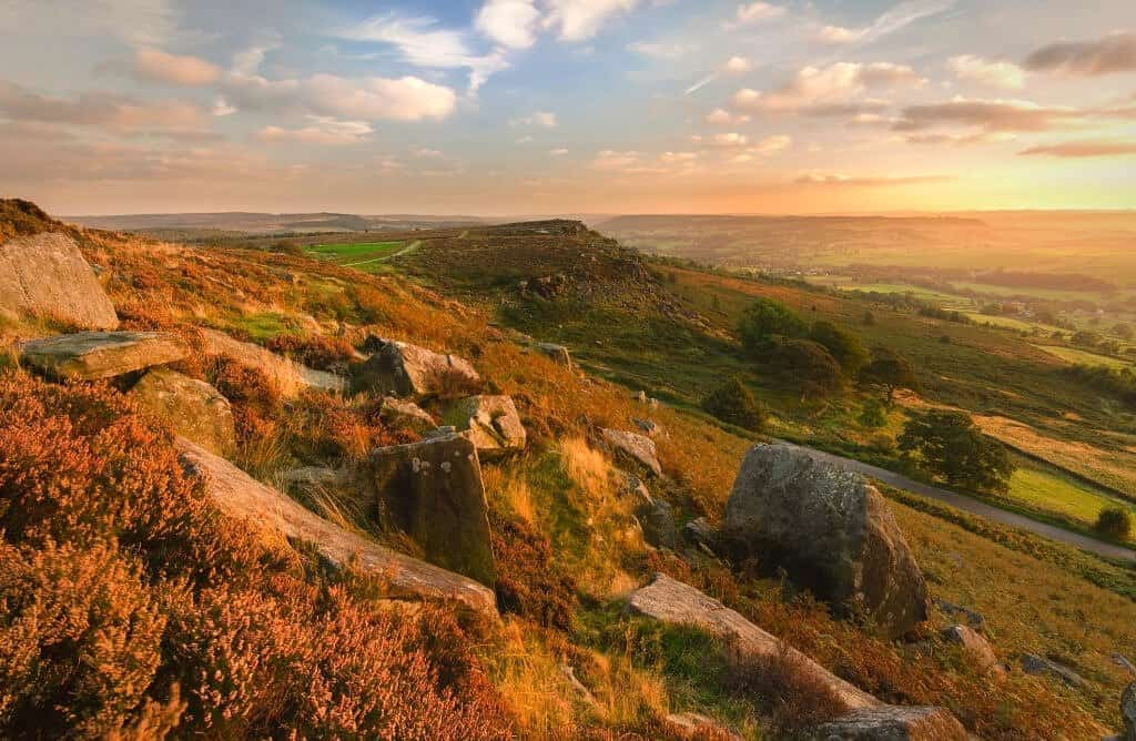 Peak district national park at sunset with rocks and countryside, perfect for going on some walks in the peak district england