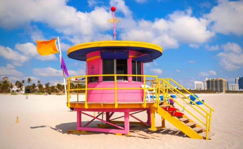 miami captions with pink beach hut