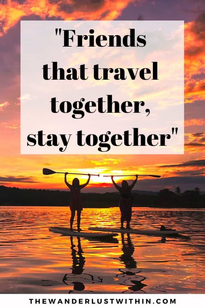 "trip with friends quotes saying ""Friends that travel together, stay together."" and two girls on Stand up paddle boards holding up their paddles in the air with an orange and pink sunset behind them"