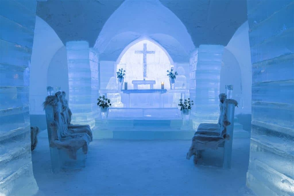 Sorrisniva Igloo Hotel on the inside has a chapel made from ice including chairs and vases in Alta Norway in winter