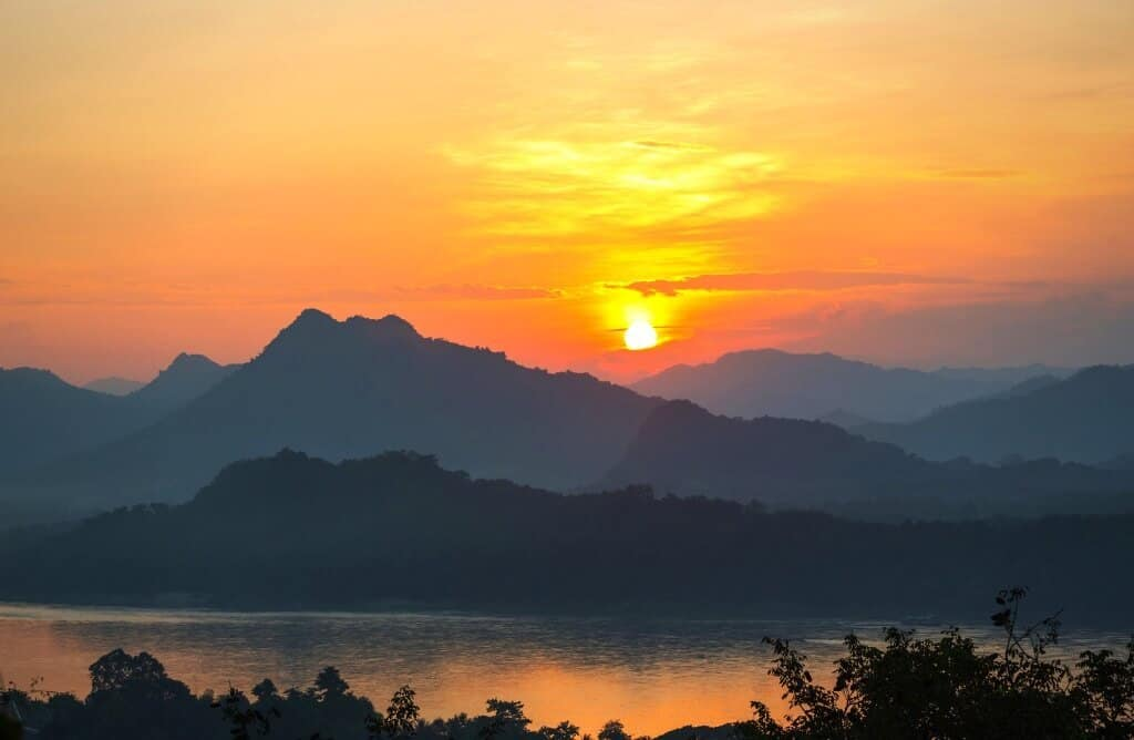 quotes on sunrise - sunrise on the mekong river in luang prabang laos with orange sky
