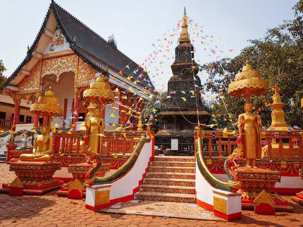 red and gold buddhist temples in Vang Vieng, visiting them is one of the best things to do in Vang Vieng Laos