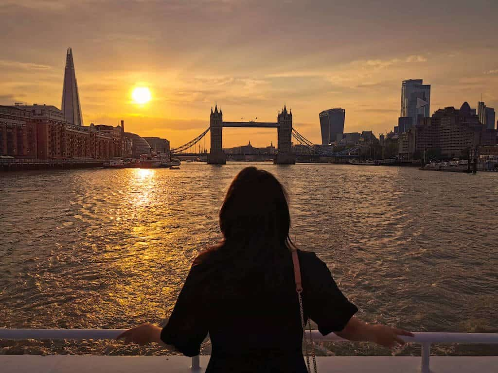 london quotes : river cruise at sunset down the river thames with the shard, tower bridge and sky garden in the background