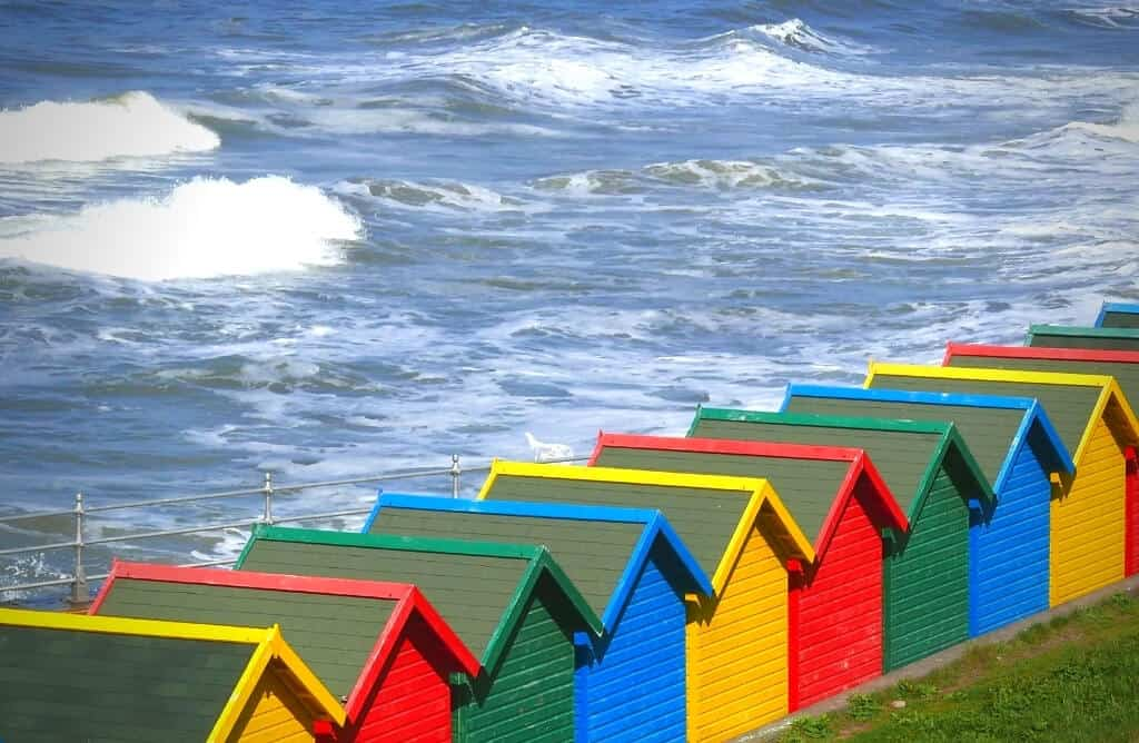 colourful beach boxes whitby beach yorkshire coast cottages in whitby