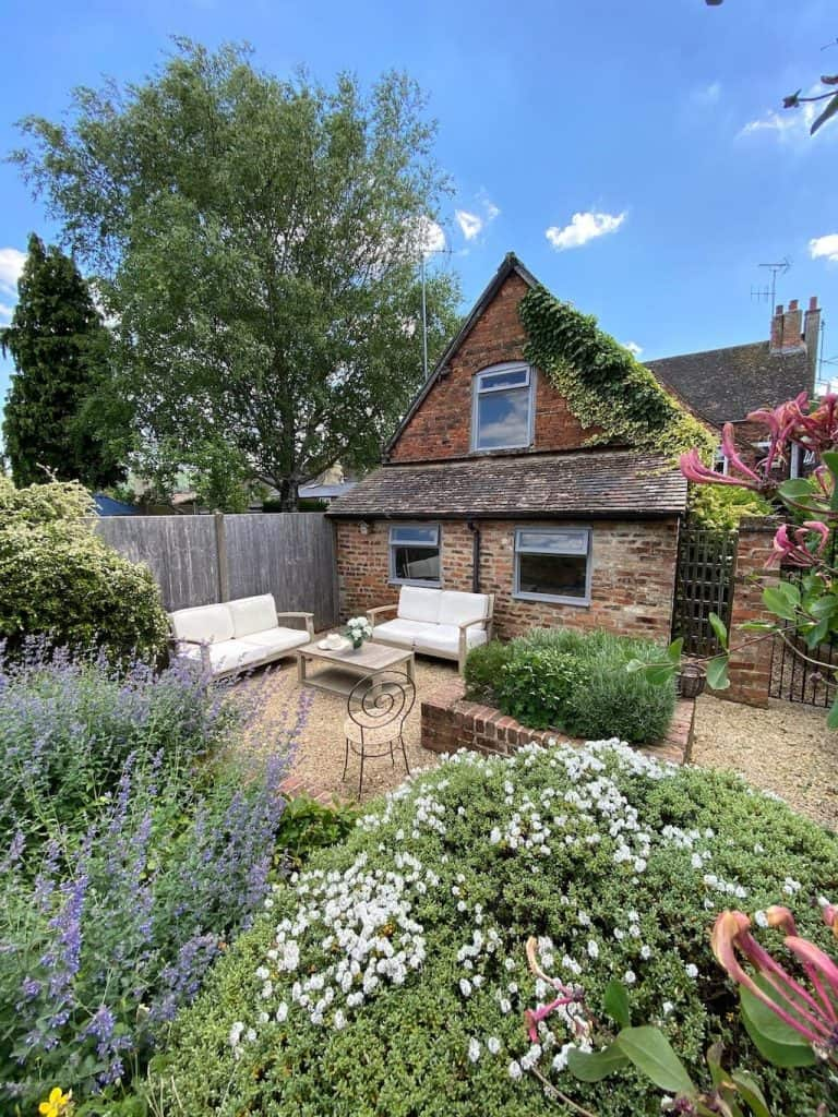 cotswolds airbnb cottage with flowers in garden