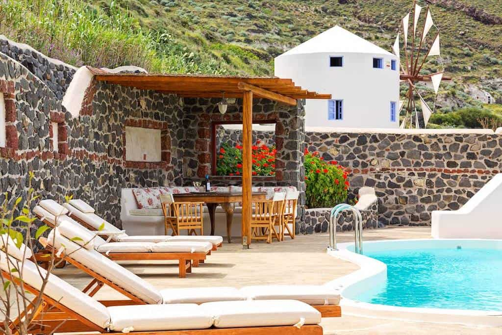 windmill santorini greece airbnb with pool outside