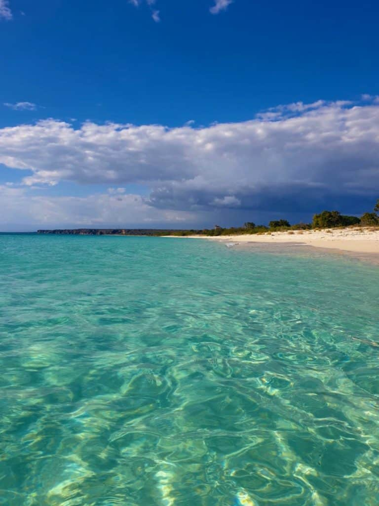 clear blue water and white sand beach in Bahia de las Aguilas off the beaten track in the Dominican Republic